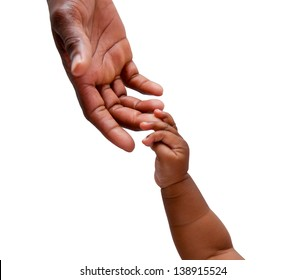 An african baby's hand reaching up to its father's hand shot on an isolated background