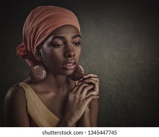 African beauty. Beautiful female portrait with ethnic dress and decorations