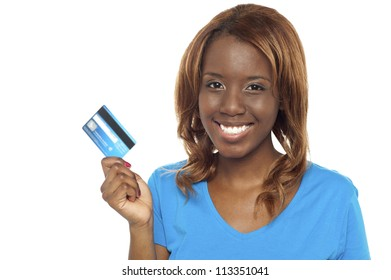 African beauty showing her credit card ready to make the payment for her purchases