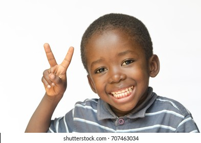 African black boy making peace sign for Africa (african ethnicity huge smile peace for the world)
