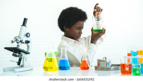 African black boy study chemical , science seriously with experimenting at laboratory.