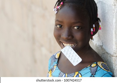 African Black Girl Holding Medical Pills Drugs with Copy Space