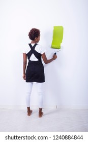 African black girl painting a wall
