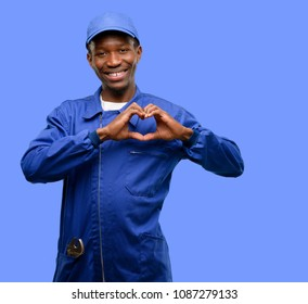 African black plumber man happy showing love with hands in heart shape expressing healthy and marriage symbol