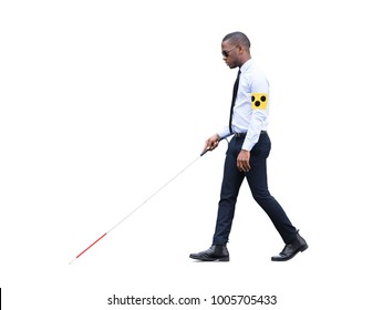 African Blind Man Wearing Armband Walking With Stick On White Background