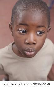 African boy giving a kiss