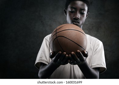 African boy holding a basket ball