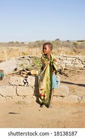 african boy living in a very poor community in a village near Kalahari desert