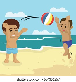 african boy playing ball with his friend in beach