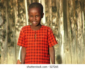 An african boy in a red outfit