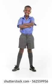 African boy wearing his school uniform and ready to go back to school.