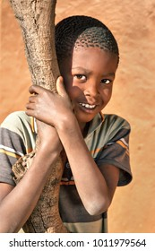 African boy in the yard of a village, Botswana