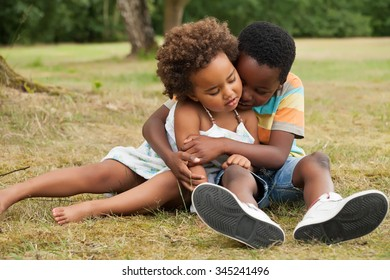 african brother and sister having fun in nature