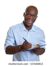 African business man writing notes on a clipboard