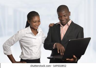 African business Partner work on notebook, Studio Shot