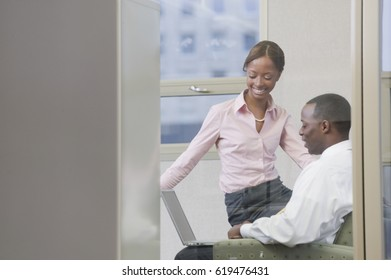 African business people working on laptop in office