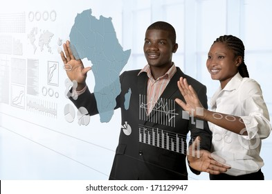 African business team working on virtual touchscreen