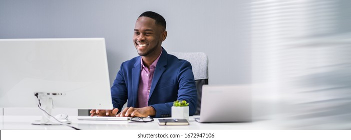 African Businessman Banner Using Computer In Office