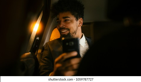 African businessman in the car