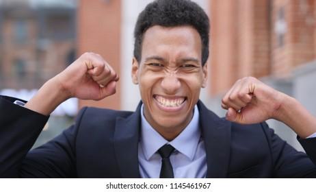 African Businessman Celebrating Success  Gesture in Offcie