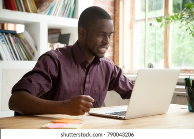 African businessman looking at laptop screen frustrated by bad news, stressed man in tension cheering sport team watching match online, black trader nervous angry about stock trading market crisis - Shutterstock ID 790043206