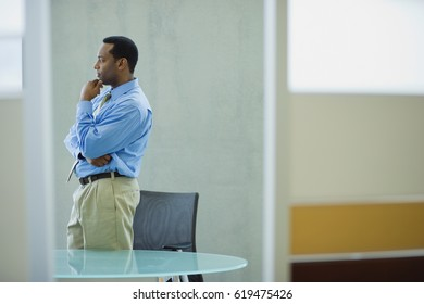 African businessman looking pensive in office