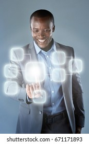African businessman in suit using futuristic hologram virtual interface display innovative modern technology