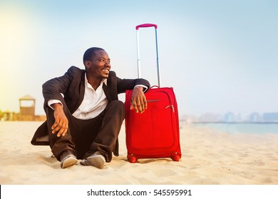 african businessman traveling to the beach