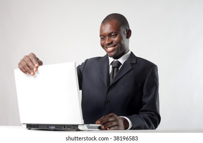 african businessman working with laptop