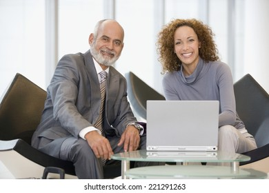 African businesspeople next to laptop