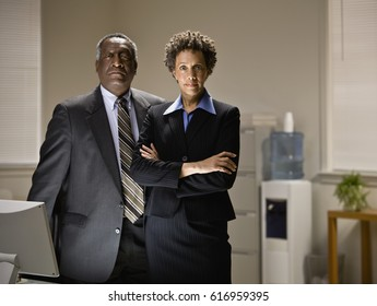 African businesspeople standing in office
