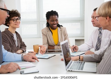 African businesswoman explains to colleague a new project in the modern office