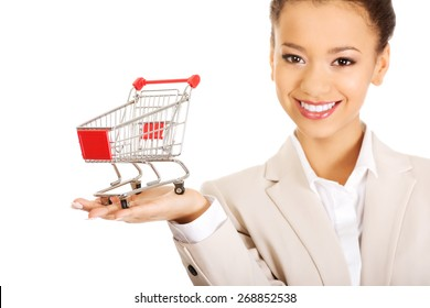 African businesswoman with shopping cart.