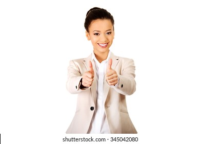 African businesswoman showing thumbs up.