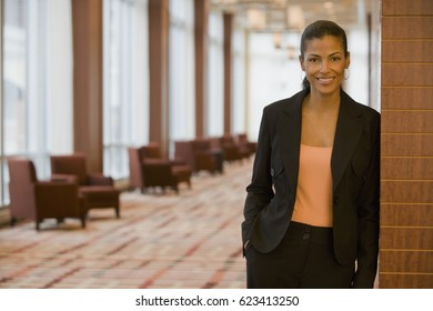 African businesswoman standing in lobby