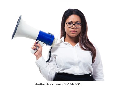 African businesswoman standing with megaphone isolated on a white background. Looking at camera