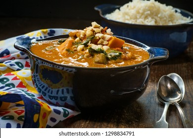 African chicken peanut stew with sweet potatoes and okra with side of basmati rice