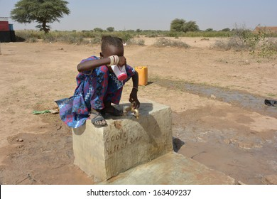 African child drinks water