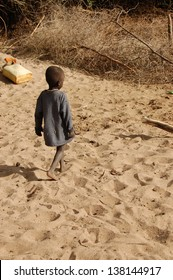 African child in dry riverbed, Uganda, Africa