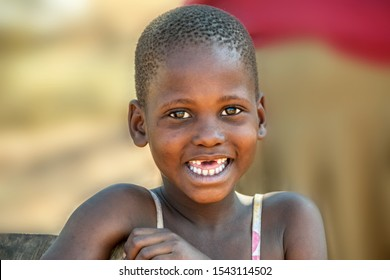 African child portrait in a dress, in a village in Botswana