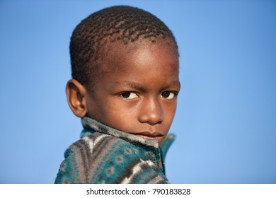 african child portrait, with sky as the background