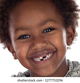 African child showing his new teeth isolated on a white background