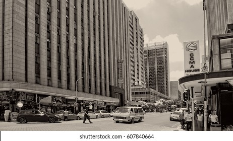 African countries. Beautiful image of modern Johannesburg. CBD. Black white photography. Urban landscape. People walk in the city. Streets of Joburg. Johannesburg, South Africa -December21,2013