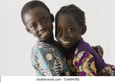 African couple of brother and sister embracing themselves, isola