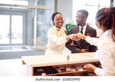 african Customer buying a vehicle at car dealership. woman and man handshaking