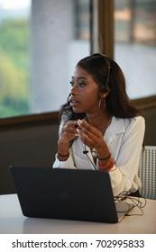 African customer support, girl service, black American secretary, receptionist calling talking, headset, headphone looking upset