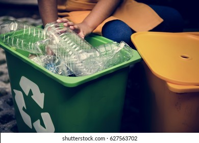 African Descent Kid Separating Recyclable Trash