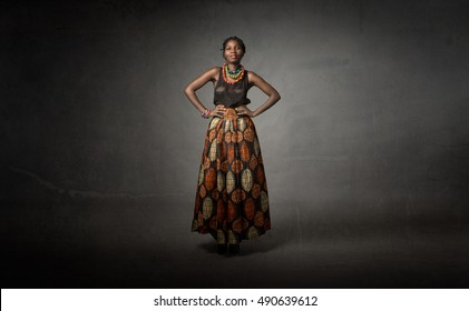 african descent in traditional dress, dark background