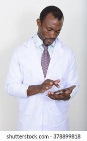 African doctor using digital tablet