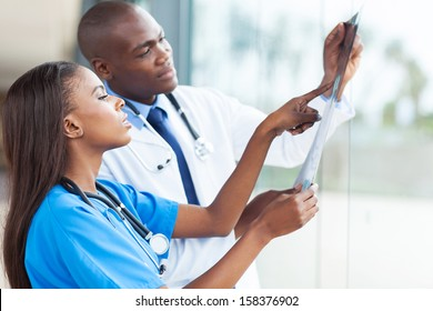 african doctors looking at patient's x-ray at hospital